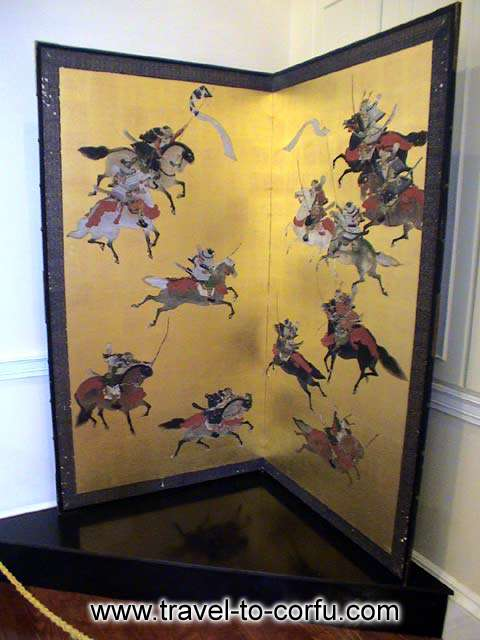 MUSEUM OF ASIAN ART - A folding screen with a painting that represents a battle.