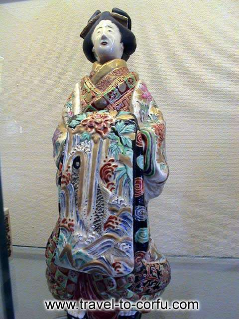 MUSEUM OF ASIAN ART - A porcelain statuette.